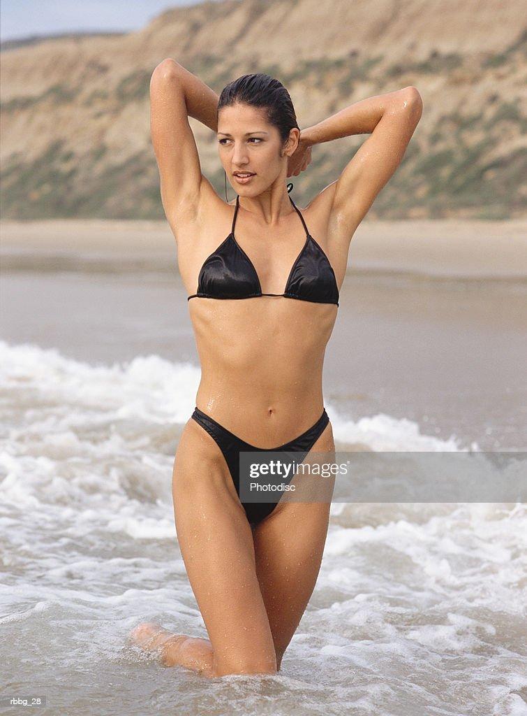 woman in bikini at the beach in the ocean : Stockfoto