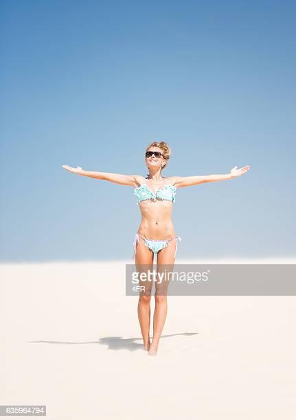 Woman in Bikini enjoying her vacation, Sand Dune in Brasil