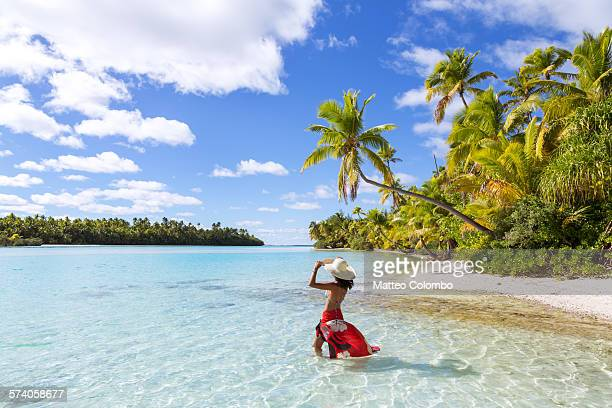Woman in bikini in the blue lagoon of Aitutaki