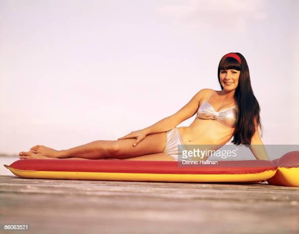Woman in bikini on raft