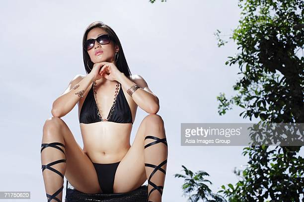 woman in bikini, resting head on hands, legs apart, facing camera - legs spread woman stock photos and pictures