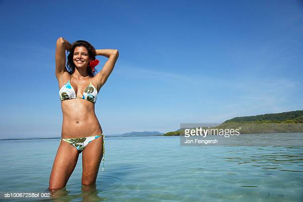 Woman in bikini, smiling