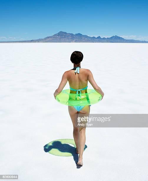 Woman in Bikini Walking in Desert.