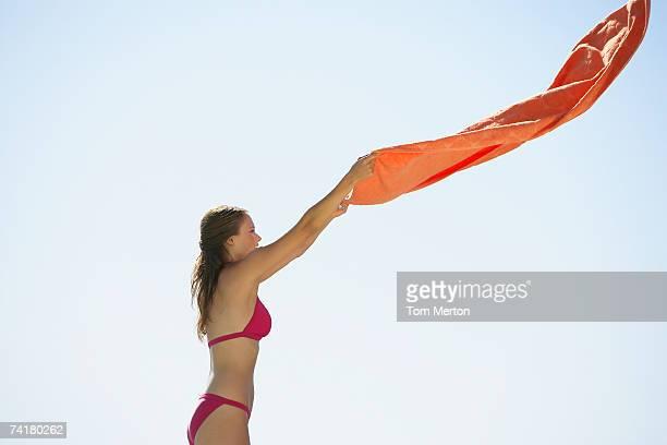 Woman in bikini with beach towel