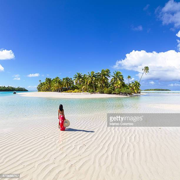 Woman in bikini with sarong on exotic island