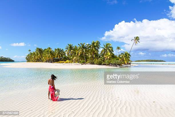 Woman in bikini with sarong on tropical beach