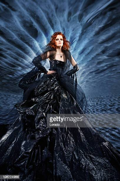 woman in black dress - long dress stock pictures, royalty-free photos & images