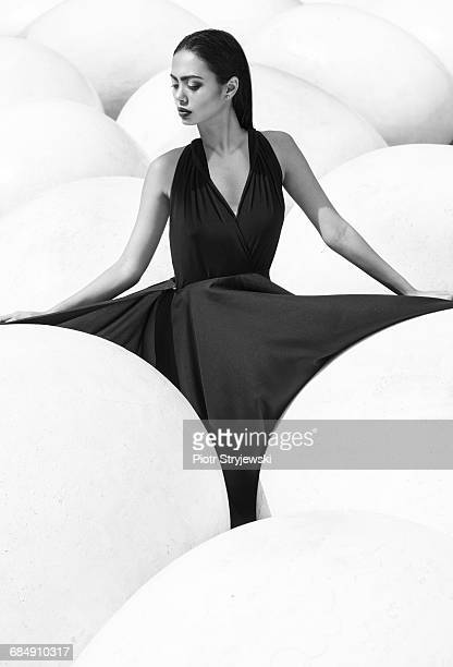 woman in black dress - embellished dress stock pictures, royalty-free photos & images