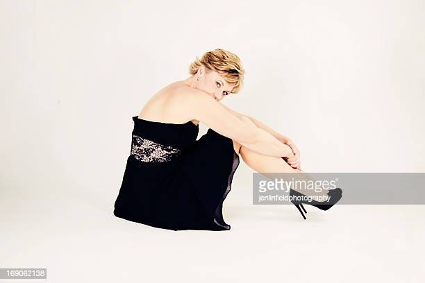 woman in black dress sitting