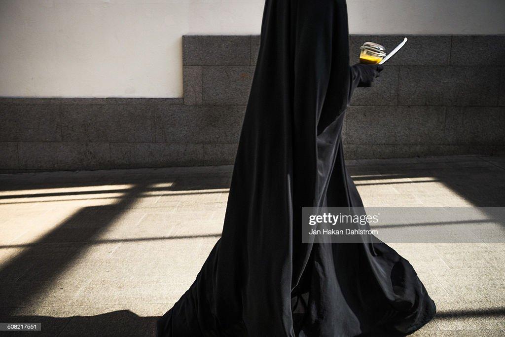 Black Dress With Gl Of Orange Juice