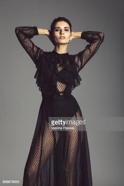 woman in black lace dress - women wearing see through clothing - fotografias e filmes do acervo
