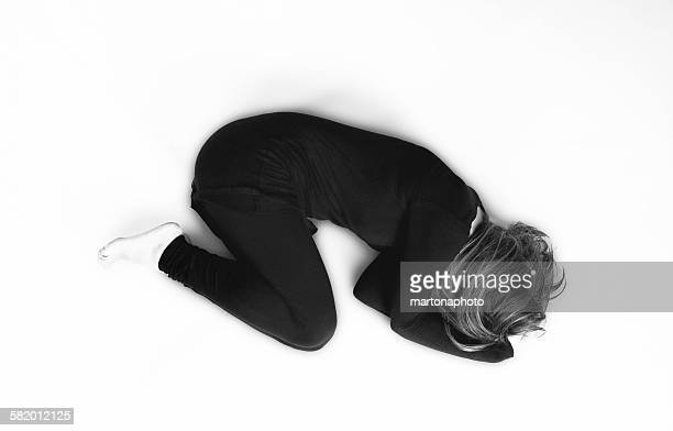 Woman in black on a white background