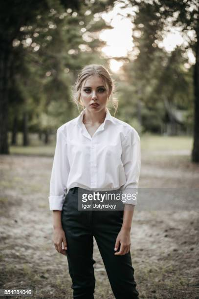 Woman in black pants and white shirt  on ranch