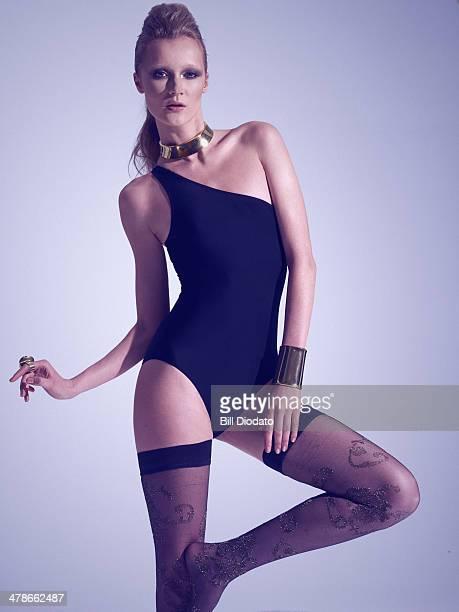 Woman in black swimsuit in studio