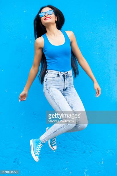 woman in blue colour jumping - blue shoe stock pictures, royalty-free photos & images