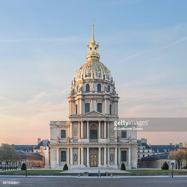 woman in blue passing by the invalides - les invalides quarter stock photos and pictures