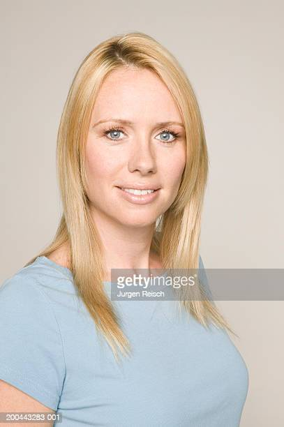 woman in blue top, portrait - straight hair stock pictures, royalty-free photos & images