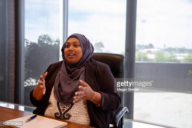Woman in boardroom meeting