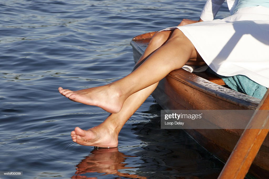 Woman in boat, low section : Foto stock