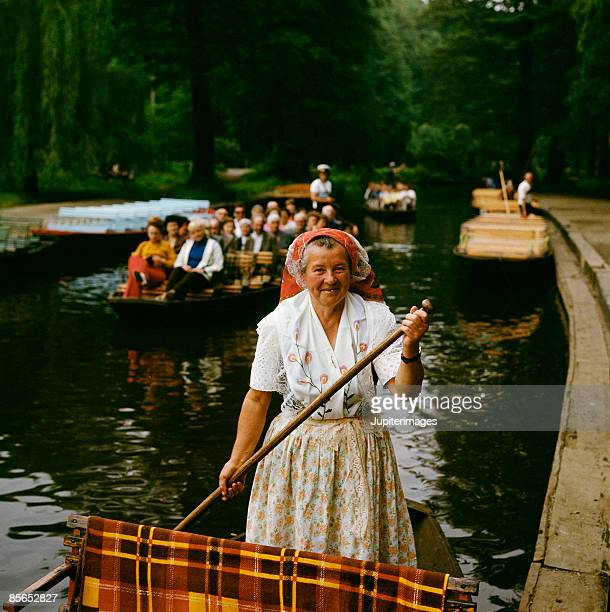 Woman in boat on canal , Brandenburg , Germany
