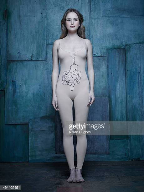 woman in body suit with intestine illustration - body paint stock pictures, royalty-free photos & images