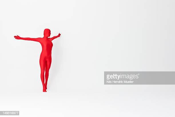 Woman in bodysuit posing