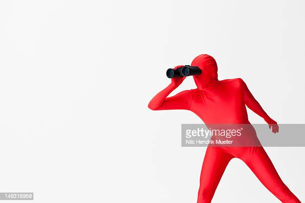 Woman in bodysuit using binoculars