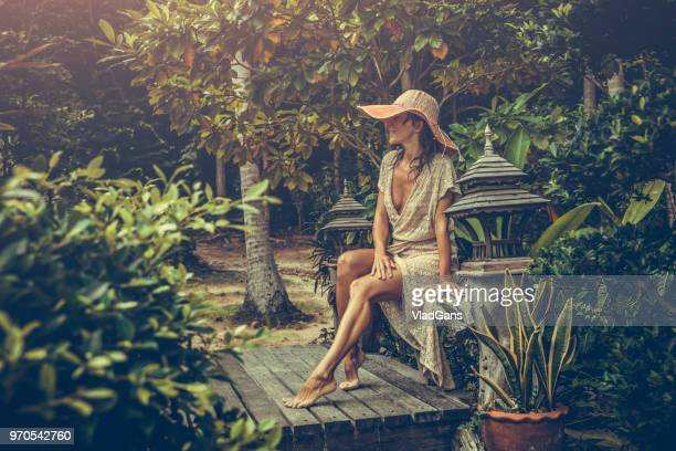 woman in boho dress in the tropics - vlad models stock photos and pictures