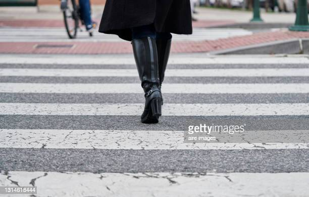 woman in boots walking on the street. - silver boot stock pictures, royalty-free photos & images