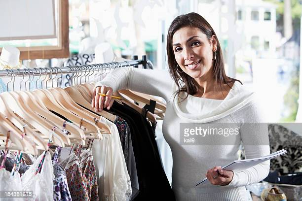 Woman in boutique taking inventory