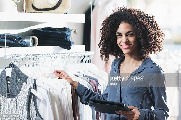 woman in boutique with digital tablet - happy merchant stock pictures, royalty-free photos & images