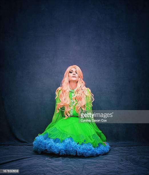 Woman in bright colors crinoline kneeling