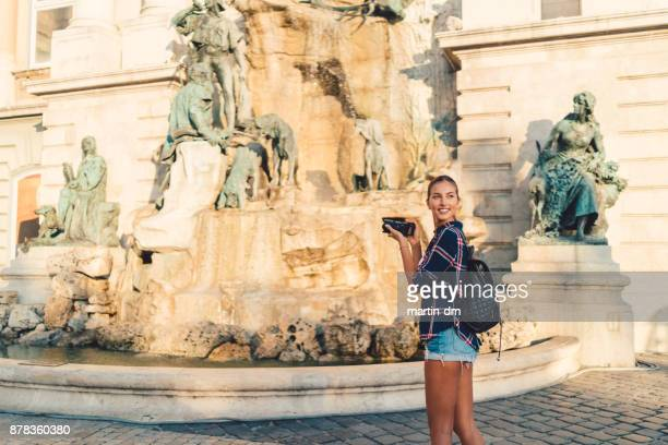 Woman in Budapest photographing the landmarks