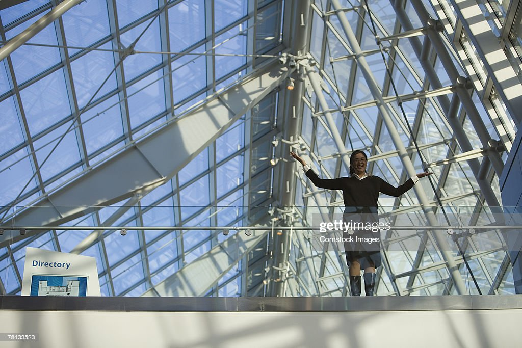 Woman in building with glass ceiling : Stockfoto