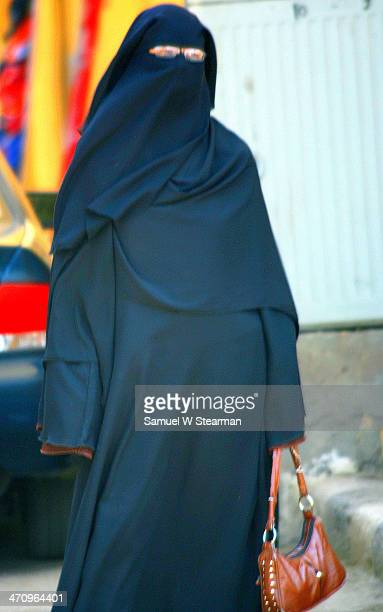 CONTENT] Woman in Burka with Handbag and Glasses the People and Sights of Luxor Egypt