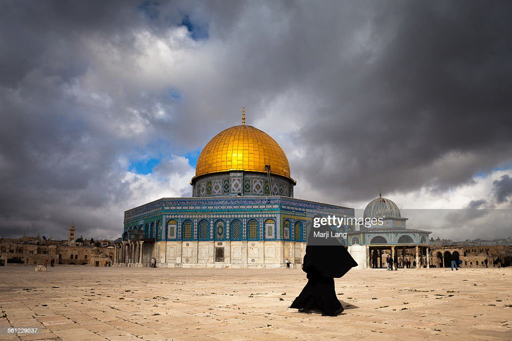 Woman in burqa by dome of the rock in Jerusalem : Stock Photo