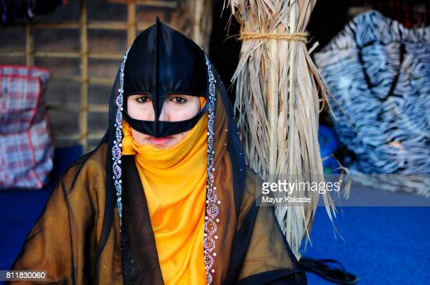 woman in burqa or abaya - muscat governorate stock pictures, royalty-free photos & images