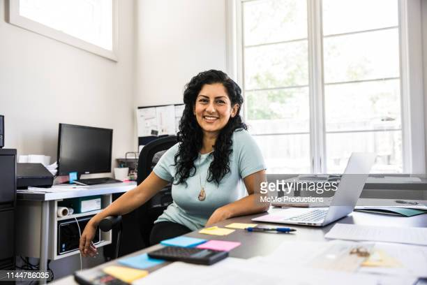 woman in business office - black hair stock pictures, royalty-free photos & images