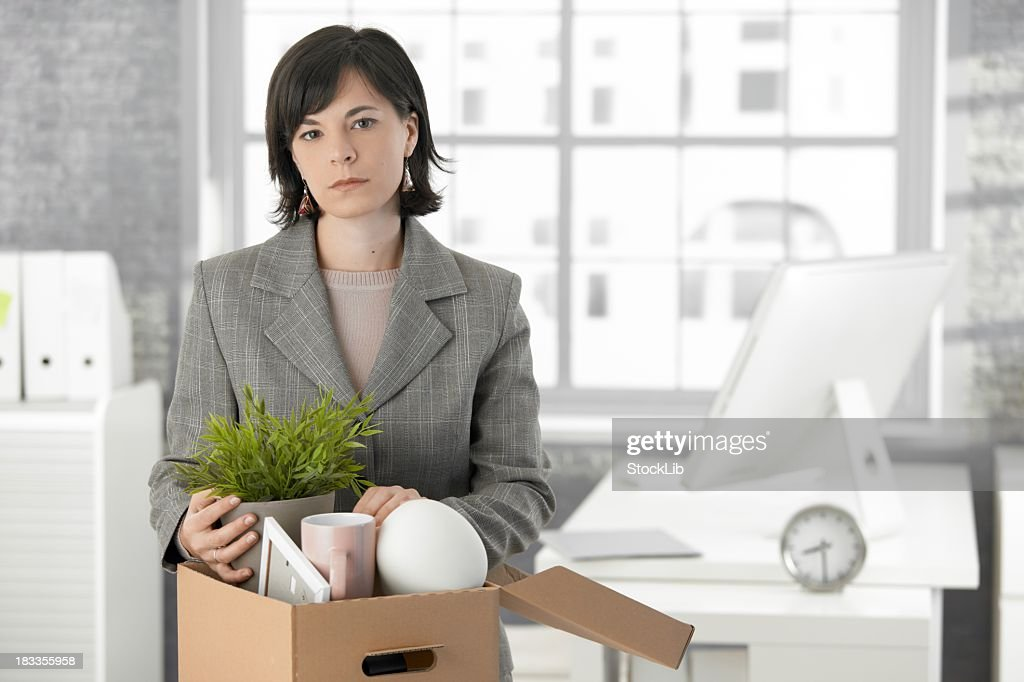 Woman in business suit with distressed expression is fired : Stock Photo