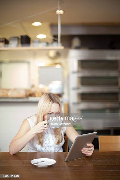 Woman in cafe looking at tablet