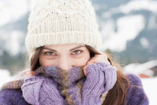 Woman in cap, scarf and gloves - gettyimageskorea