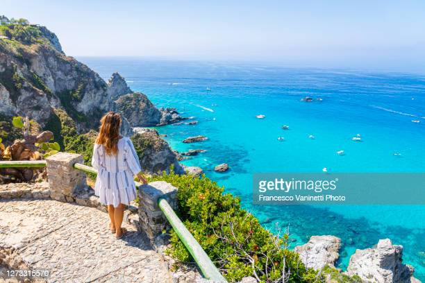 woman in capo vaticano, above the beaches of praia i focu, calabria, italy. - calabria stock pictures, royalty-free photos & images