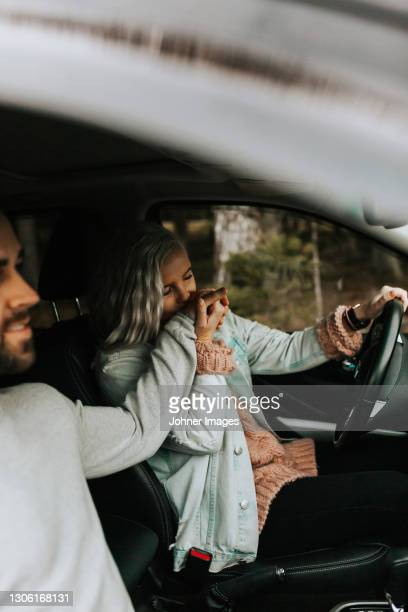 woman in car kissing mans hand - västra götaland county stock pictures, royalty-free photos & images