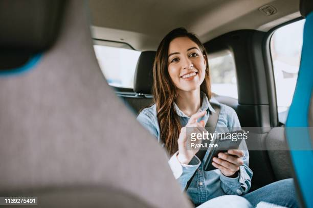 woman in car rideshare in city of los angeles - car pooling stock photos and pictures