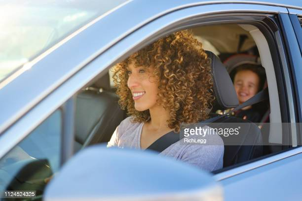 woman in car with little boy - driving stock pictures, royalty-free photos & images