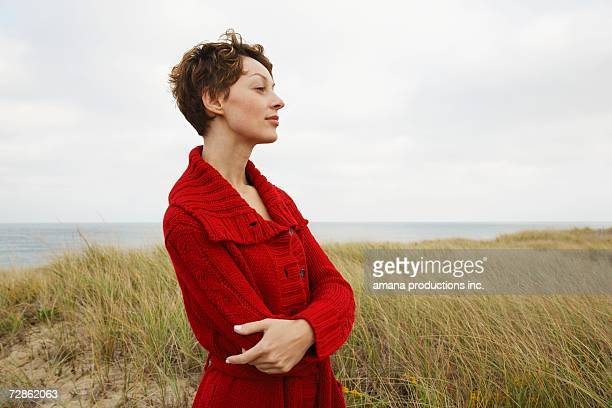 woman in cardigan at beach - mid adult women stock pictures, royalty-free photos & images