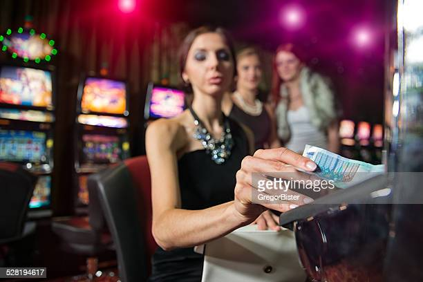 woman in casino - teen pokies stock photos and pictures