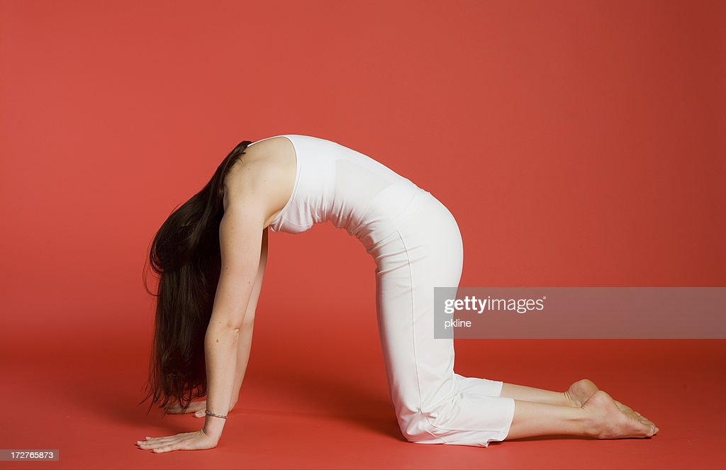 Woman in Cat/Cow Pose : Stock Photo