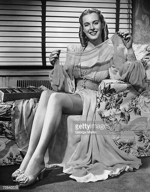 Woman in chair holding stockings