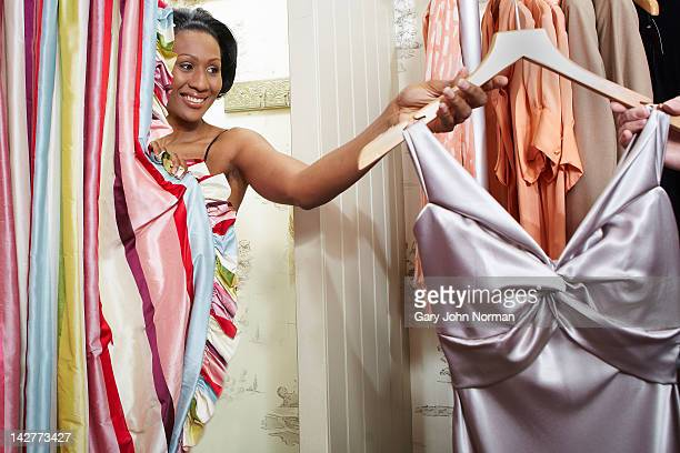 woman in changing room of boutique shop - evening gown stock pictures, royalty-free photos & images